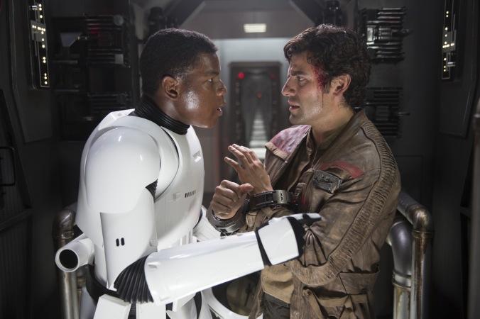 Star Wars: The Force Awakens..L to R: Finn (John Boyega) and Poe Dameron (Oscar Isaac)..Ph: David James..© 2015 Lucasfilm Ltd. & TM. All Right Reserved.