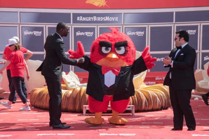 "Cannes, France - May 10, 2016: Omar Sy (French Voice of ""Red"") and Josh Gad (American Voice of ""Chuck"") with Red at the Photo Call for Columbia Pictures and Rovio Animations' ANGRY BIRDS."