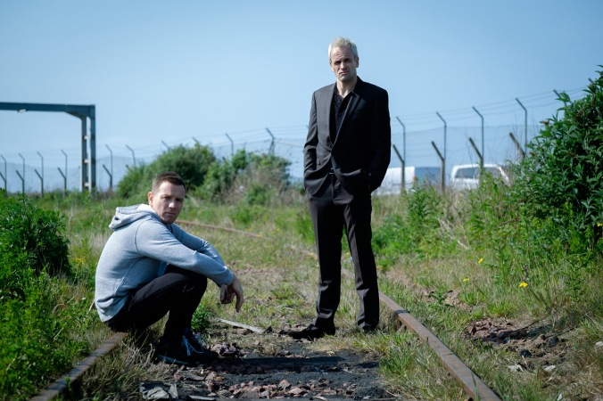 Ewan McGregor as Mark Renton and Jonny Lee Miller as Simon on railway tracks in TriStar PicturesÕ T2: TRAINSPOTTING