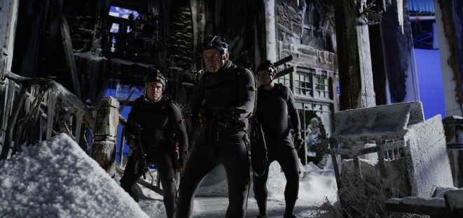 "L-r, Terry Notary, Andy Serkis and Michael Adamthwaite on the set of Twentieth Century Fox's ""War for the Planet of the Apes."""