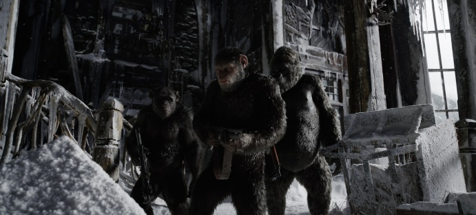 "L-r, Terry Notary, Andy Serkis and Michael Adamthwaite in Twentieth Century Fox's ""War for the Planet of the Apes."""
