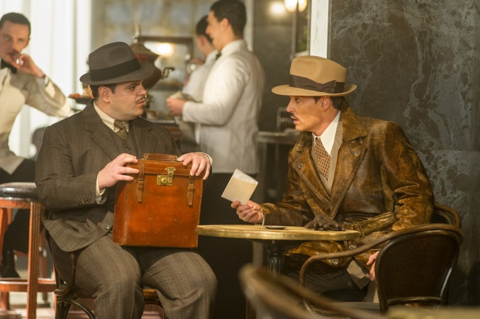 "Josh Gad, left, and Johnny Depp star in Twentieth Century Fox's ""Murder on the Orient Express."""