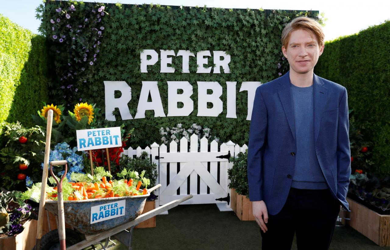 "Cast member Gleeson poses at a photo call for the movie ""Peter Rabbit"" in West Hollywood"
