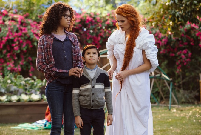 Storm Reid is Meg Murry, Deric McCabe is Charles Wallace Murry and Reese Witherspoon is Mrs. Whatsit in Disney's A WRINKLE IN TIME.