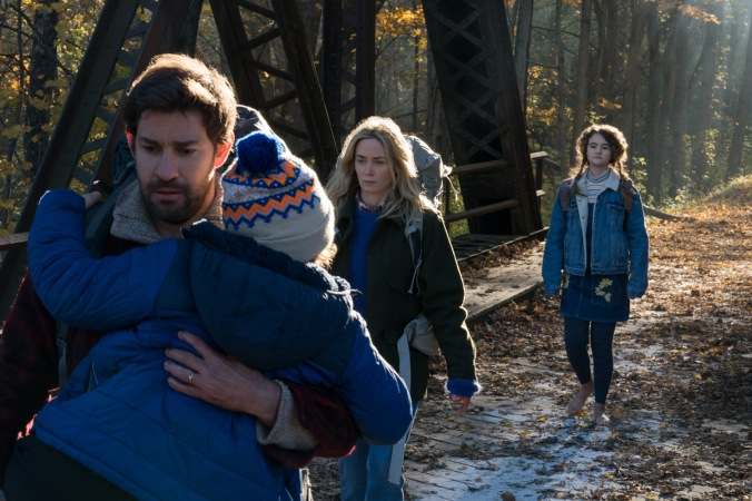Left to right: Noah Jupe plays Marcus Abbott, John Krasinski plays Lee Abbott, Emily Blunt plays Evelyn Abbott and Millicent Simmonds plays Regan Abbott in A QUIET PLACE, from Paramount Pictures.