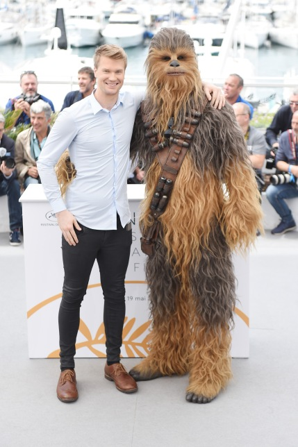 CANNES, FRANCE - MAY 15: Actor Joonas Suotamo poses with the character he plays of Chewbacca (in costume) as they attend the 'Solo: A Star Wars Story' official photocall at Palais des Festivals on May 15, 2018 in Cannes, France. (Photo by Antony Jones/Getty Images for Disney) *** Local Caption *** Joonas Suotamo