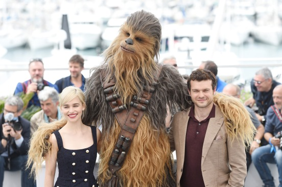 CANNES, FRANCE - MAY 15: (L-R) Emilia Clarke, Chewbacca (in costume) and Alden Ehrenreich attend the 'Solo: A Star Wars Story' official photocall at Palais des Festivals on May 15, 2018 in Cannes, France. (Photo by Antony Jones/Getty Images for Disney) *** Local Caption *** Emilia Clarke; Chewbacca; Alden Ehrenreich