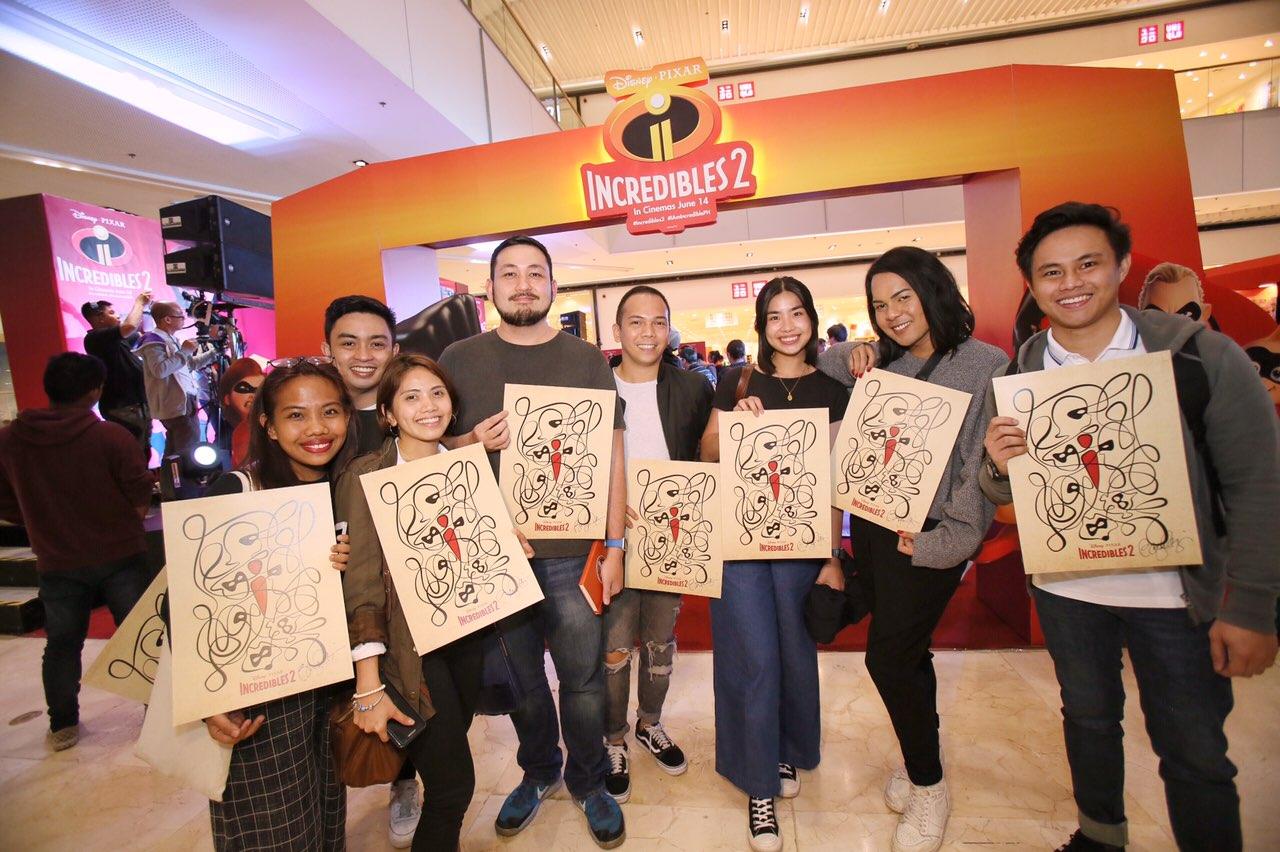 Workshop Participants with Signed I2 artwork