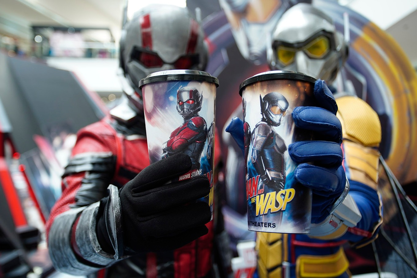 Ant-Man and The Wasp cosplayers with the exclusive Snacktime tumblers
