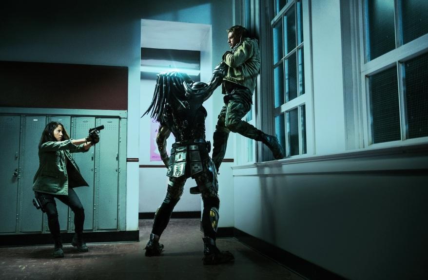 "Olivia Munn, left, and Boyd Holbrook star in Twentieth Century Fox' ""The Predator."""