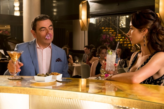 Rowan Atkinson as Johnny English and Olga Kurylenko as Ophelia star in JOHNNY ENGLISH STRIKES AGAIN, a Focus Features release.