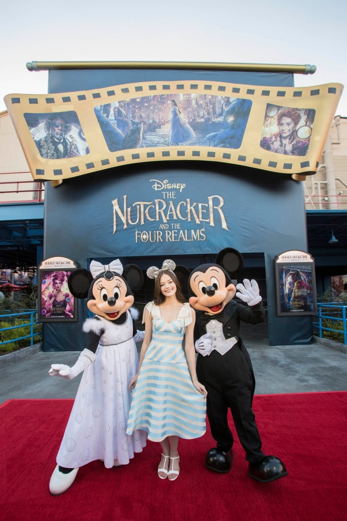 "Actress Mackenzie Foy, star of Disney's ""The Nutcracker and the Four Realms,"" celebrates the film's sneak peek with Mickey Mouse and Minnie Mouse at Disney California Adventure in Anaheim, Calif., Oct. 4, 2018. A 12-minute preview of ""The Nutcracker and the Four Realms"" begins Friday, Oct. 5, at Disney California Adventure in Anaheim, Calif. and at Disney's Hollywood Studios in Lake Buena Vista, Fla. (Joshua Sudock/Disneyland Resort)"