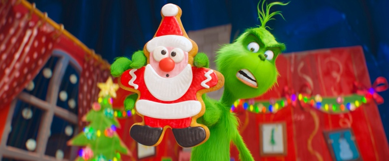 The Grinch (Benedict Cumberbatch) warns his dog Max and reindeer Fred about the seductive power of the Santa cookie as he trains them to help him steal Christmas in Dr. Seuss' The Grinch from Illumination.