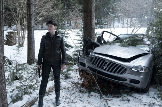 Lisbeth Salander (Claire Foy) and a crashed Maserati in Columbia Pictures' THE GIRL IN THE SPIDER'S WEB""