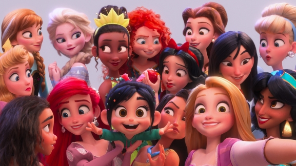 "SELFIE! – In ""Ralph Breaks the Internet,"" Vanellope von Schweetz hits the internet where she encounters and then befriends the Disney princesses. Filmmakers invited the original voice talent to return to the studio to help bring their characters to life, including Sarah Silverman (Vanellope in ""Ralph Breaks the Internet""), Auli'i Cravalho (""Moana""), Kristen Bell (Anna in ""Frozen""), Idina Menzel (Elsa in ""Frozen""), Kelly MacDonald (Merida in ""Brave""), Mandy Moore (Rapunzel in ""Tangled""), Anika Noni Rose (Tiana in ""The Princess and the Frog""), Ming-Na Wen (""Mulan""), Irene Bedard (""Pocahontas""), Linda Larkin (Jasmine in ""Aladdin""), Paige O'Hara (Belle in ""Beauty and the Beast""), and Jodi Benson (Ariel in ""The Little Mermaid""). ©2018 Disney. All Rights Reserved."