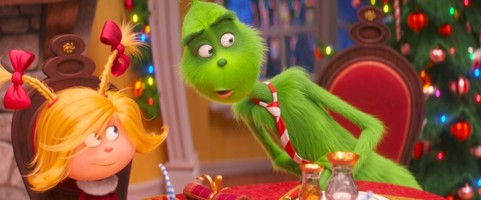 (from left) Cindy-Lou Who (Cameron Seely) helps liberate the Grinch (Benedict Cumberbatch) from his grumpiness in Dr. Seuss' The Grinch from Illumination.
