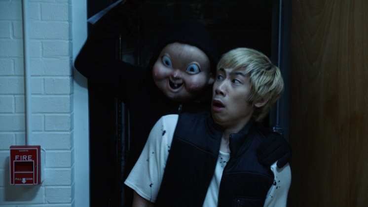"""Ryan (Phi Vu) under attack from """"Babyface"""" in """"Happy Death Day 2U,"""" written and directed by Christopher Landon."""