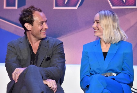"BEVERLY HILLS, CA - FEBRUARY 22: Actors Jude Law (L) and Brie Larson speak onstage during Marvel Studios' ""Captain Marvel"" Global Junket Press Conference at The Beverly Hilton Hotel on February 22, 2019 in Beverly Hills, California. (Photo by Alberto E. Rodriguez/Getty Images for Disney) *** Local Caption *** Jude Law; Brie Larson"