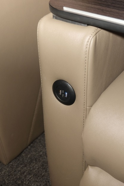 Charging ports located at the side of the chair
