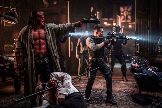 David Harbour as 'Hellboy', Sasha Lane as 'Alice Monoghan', and Daniel Day Kim as 'Ben Daimio' in HELLBOY. Photo Credit: Mark Rogers.