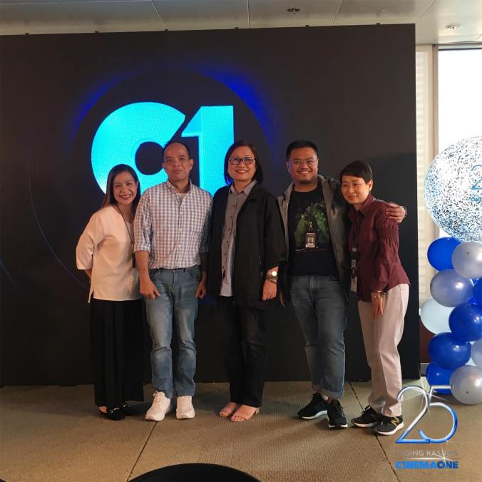 Cinema One channel head Ronald Arguelles with ABS-CBN Films head Olivia Lamasan