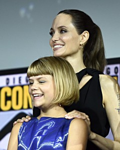 SAN DIEGO, CALIFORNIA - JULY 20: Angelina Jolie and Lia McHugh of Marvel Studios' 'The Eternals' at the San Diego Comic-Con International 2019 Marvel Studios Panel in Hall H on July 20, 2019 in San Diego, California. (Photo by Alberto E. Rodriguez/Getty Images for Disney)