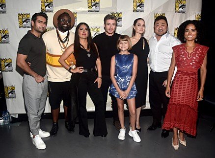 SAN DIEGO, CALIFORNIA - JULY 20: (L-R) Kumail Nanjiani, Brian Tyree Henry, Salma Hayek, Richard Madden, Lia McHugh, Angelina Jolie, Don Lee and Lauren Ridloff of Marvel Studios' 'The Eternals' at the San Diego Comic-Con International 2019 Marvel Studios Panel in Hall H on July 20, 2019 in San Diego, California. (Photo by Alberto E. Rodriguez/Getty Images for Disney)