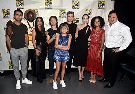 SAN DIEGO, CALIFORNIA - JULY 20: (L-R) Kumail Nanjiani, Brian Tyree Henry, Salma Hayek, Director Chloe Zhao, Lia McHugh, Richard Madden, Angelina Jolie, Lauren Ridloff and Don Lee of Marvel Studios' 'The Eternals' at the San Diego Comic-Con International 2019 Marvel Studios Panel in Hall H on July 20, 2019 in San Diego, California. (Photo by Alberto E. Rodriguez/Getty Images for Disney)