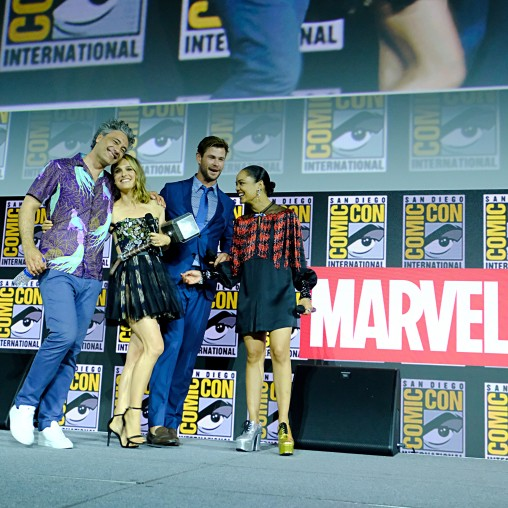 SAN DIEGO, CALIFORNIA - JULY 20: (L-R) Director Taika Waititi, Natalie Portman, Chris Hemsworth and Tessa Thompson of Marvel Studios' 'Thor: Love and Thunder' at the San Diego Comic-Con International 2019 Marvel Studios Panel in Hall H on July 20, 2019 in San Diego, California. (Photo by Alberto E. Rodriguez/Getty Images for Disney)