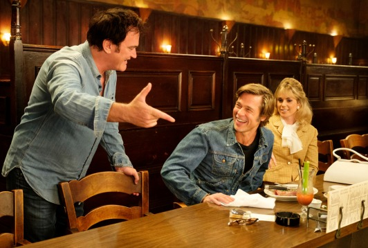Quentin Tarantino and Brad Pitt on the set of ONCE UPON TIME IN HOLLYWOOD. (woman in shot: ELISE NYGAARD OLSON)