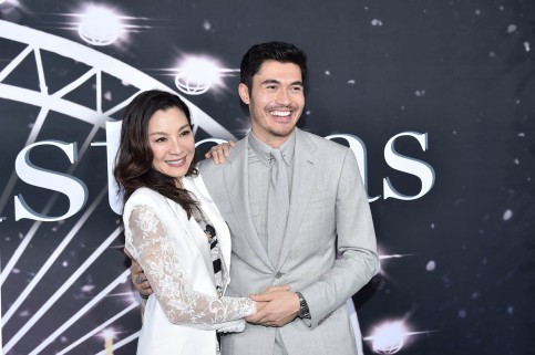 "NEW YORK, NEW YORK - OCTOBER 29: Michelle Yeoh and Henry Golding attend ""Last Christmas"" New York premiere at AMC Lincoln Square Theater on October 29, 2019 in New York City. (Photo by Steven Ferdman/WireImage,)"