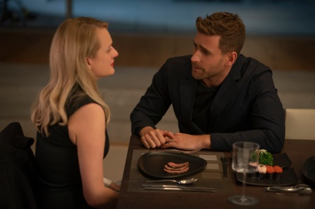 "(from left) Cecilia Kass (Elisabeth Moss, back to camera) and Adrian Griffin (Oliver Jackson-Cohen) in ""The Invisible Man,"" written and directed by Leigh Whannell."
